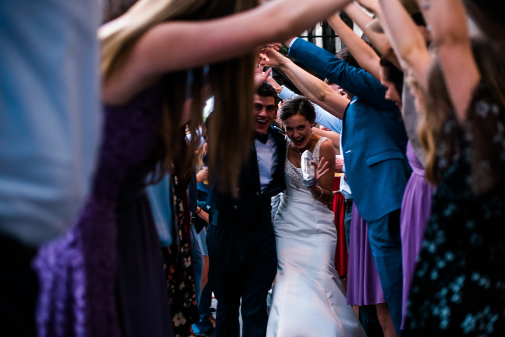 Boise Wedding Photographer // Idaho engagement photographer // PNW Engagement // Wedding // Idaho bride // Natural Couples Posing Ideas // wedding exit // tunnel exit //air force wedding // elegant wedding dress // open back wedding dress // boise basque center // catholic wedding // party reception // wedding reception dancing // simple wedding ideas // getting ready wedding // inn at 500 boise // boise couples photographer // SS Photography & Design // Sadie Shirts