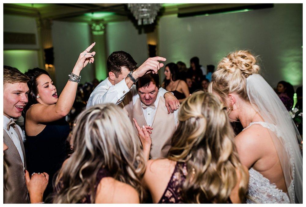 Boise Wedding Photographer, Idaho Wedding Photographer, candlelit wedding, plum and gold wedding colors, winter wedding, reception, fun dancing, shutter drag, chandelier, lace wedding dress, wedding updo, documentary wedding photographer, wedding photography, large group wedding, church wedding