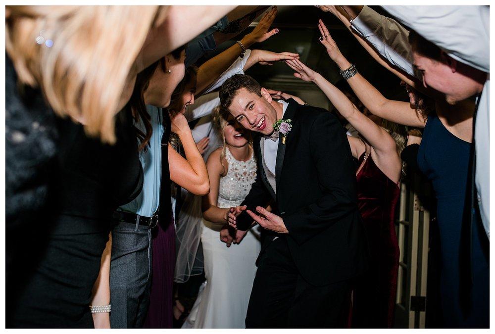 Boise Wedding Photographer, Idaho Wedding Photographer, candlelit wedding, plum and gold wedding colors, winter wedding, tunnel grand exit, reception, fun dancing, shutter drag, chandelier, lace wedding dress, wedding updo, documentary wedding photographer, wedding photography, large group wedding, church wedding