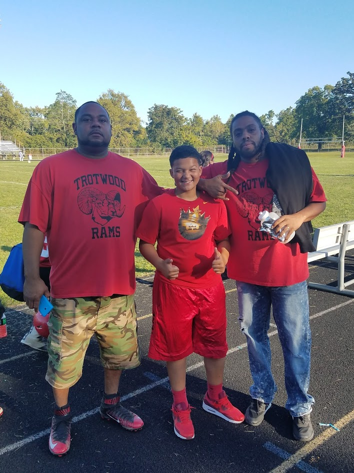 Issiah with the Trotwood Weerams Football Staff