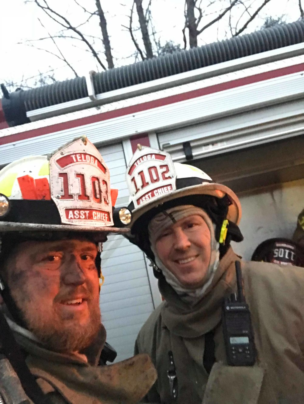 Andy (left) while on firefighter duties