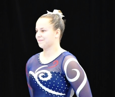 OLIVIA HICKS  is a 19 year old gymnast who started at the age of 6, and absolutely loves it. She is currently studying exercise and sport science, and hopes to continue to pursue a masters in strength and conditioning.