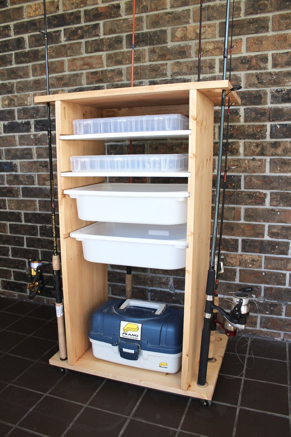 "Rod holder with two storage shelves and two 4"" deep sliding storage boxes."