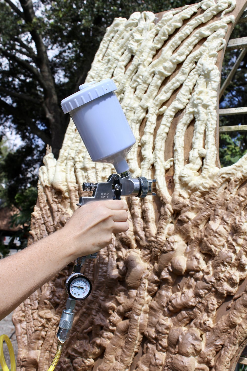 This HVLP spray gun makes it easy to paint those hard-to-reach recesses