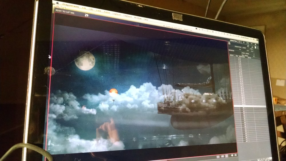 Live feed of clouds superimposed over a still from the film.  Part of the process of developing the right shape and appearance for the clouds.  Photograph by Vanessa Pridgen