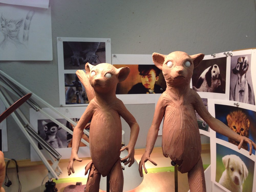 Clay sculptures of Bernard and Elba in progress.