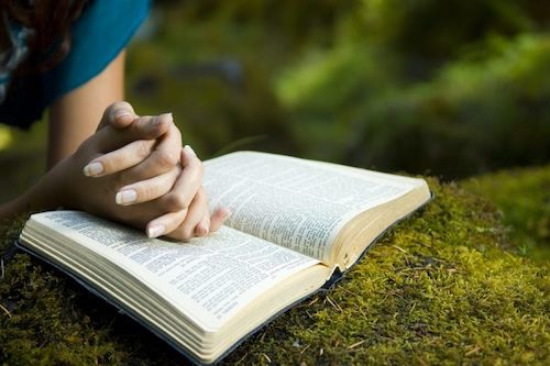 bigstock-Young-Woman-Reading-Bible-10393223-600x399.jpg