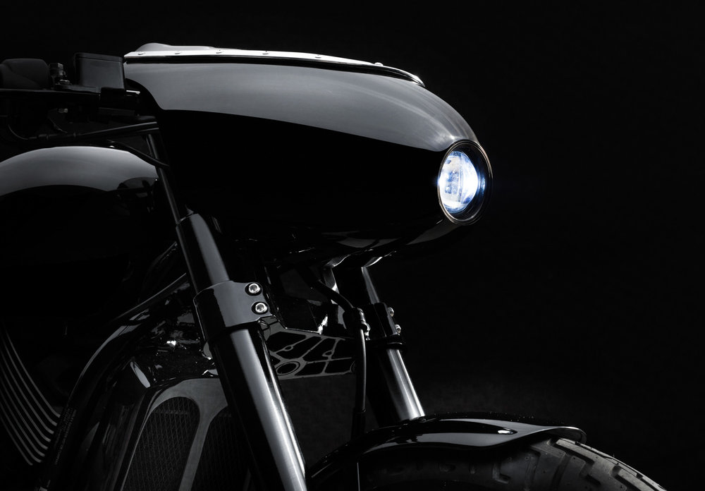 Convex LED Lens  Mounted on the front is a custom white LED lens. The convex quartz glass spreads the beam and brightens the road by more than 150% than a standard halogen lamp.