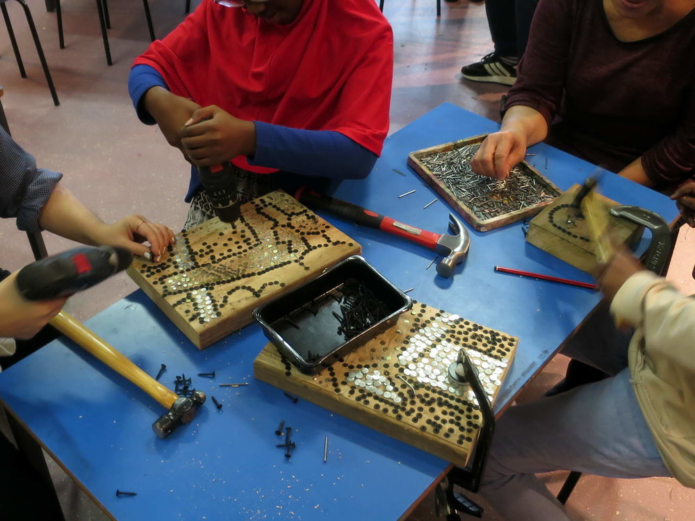 Pupils and staff drove in screws and hammered in nails following traced outlines of the design. Different metals, sizes and finishes created definition.