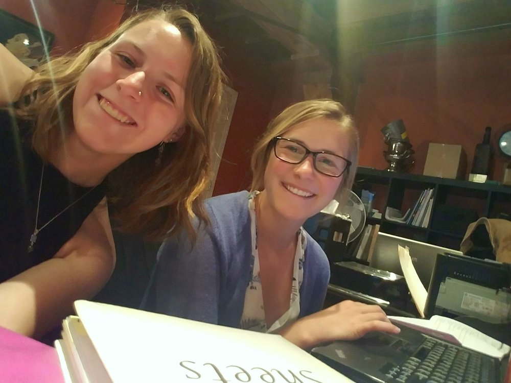 This is Marissa (right) and me (left) at our desks!
