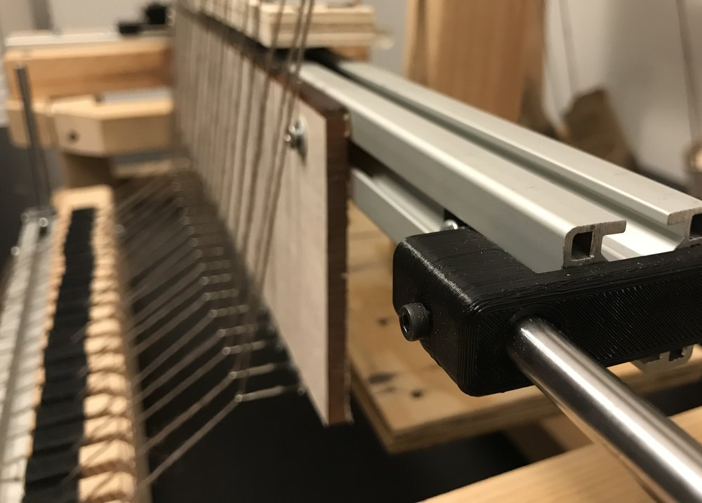 I designed 3D printed inserts to attach the extruded aluminum to the linear shafts.