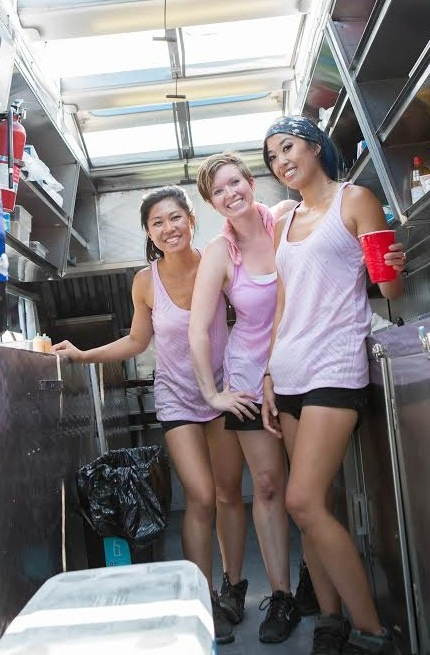 Team Pho-Nomenal's Becca Ruffin, Sophia Woo and Sunny Lin pose in their truck after the selling challenge in Springfield, Illinois as seen on Food Network's, The Great Food Truck Race, Season 6.