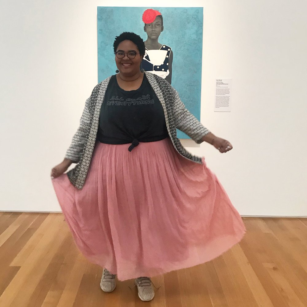Aspiring Co. Founder Danae Edmonds in front of Amy Sherald's Miss Everything at North Carolina Museum of Art