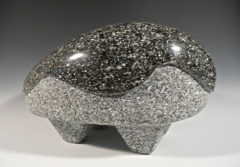 """Boulderness #5"" Carved speckled black granite from Sloan Peak on the Mountain Loop 14.5""W x 8""H x 10""D by Reg Akright"