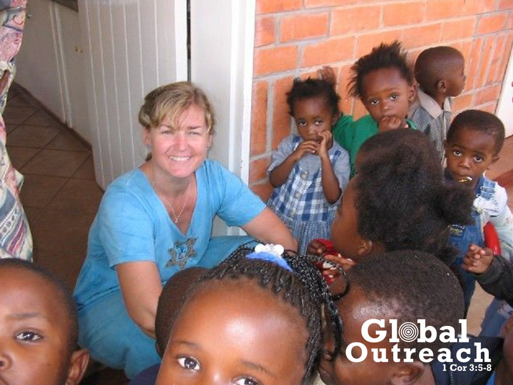 Kathy and KG kids.jpg