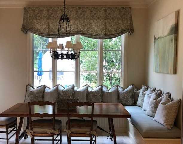 Breakfast Room Banquette gets a makeover with new valance, cushions and pillows.  Love how light and airy this room feels!  #atlantacustominteriors #customwindowtreatments #custompillows #custombanquettecushions #customchaircushionswithties #customvalance #lovemyjob #funtrim #itsallinthedetails #lightandairynow