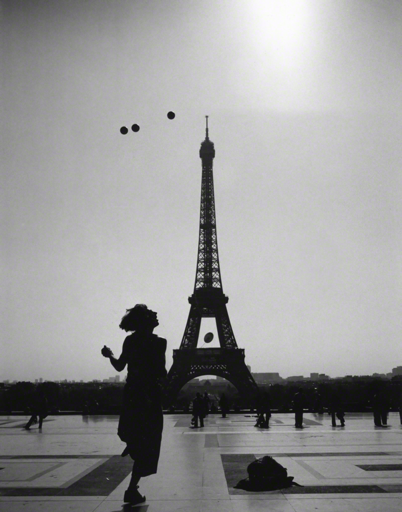 The Joy of Living.  Looking for a different way to capture La Tour Eiffel, as I strolled across the Trocadero, the young man started juggling. This iconic image has given back to Paris through  Secours Populaire Français , and helped  raise money for the late photographer Anton Hammerl 's children.