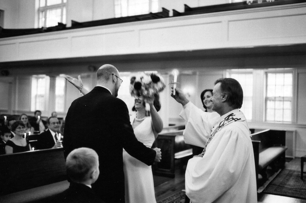 """You may kiss the bride.""  To get this close, I asked the pastor about his policy on photographing during the ceremony."