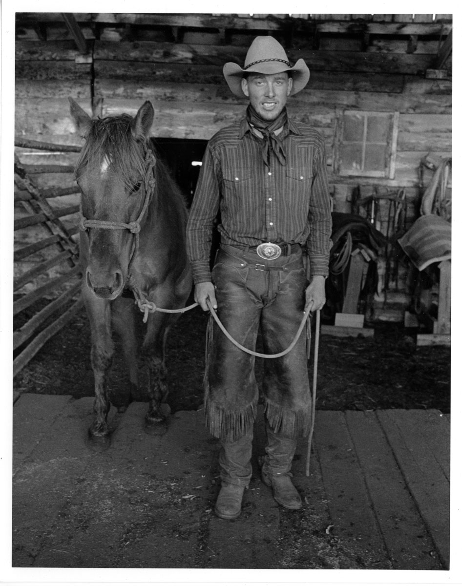 Michael Pearson, Bondurant Wyoming.  While I was making pictures of anvils and saddles in the barn, the cowboys came in and saddled up their horses. The soft, even light inside was perfect for a quick portrait.