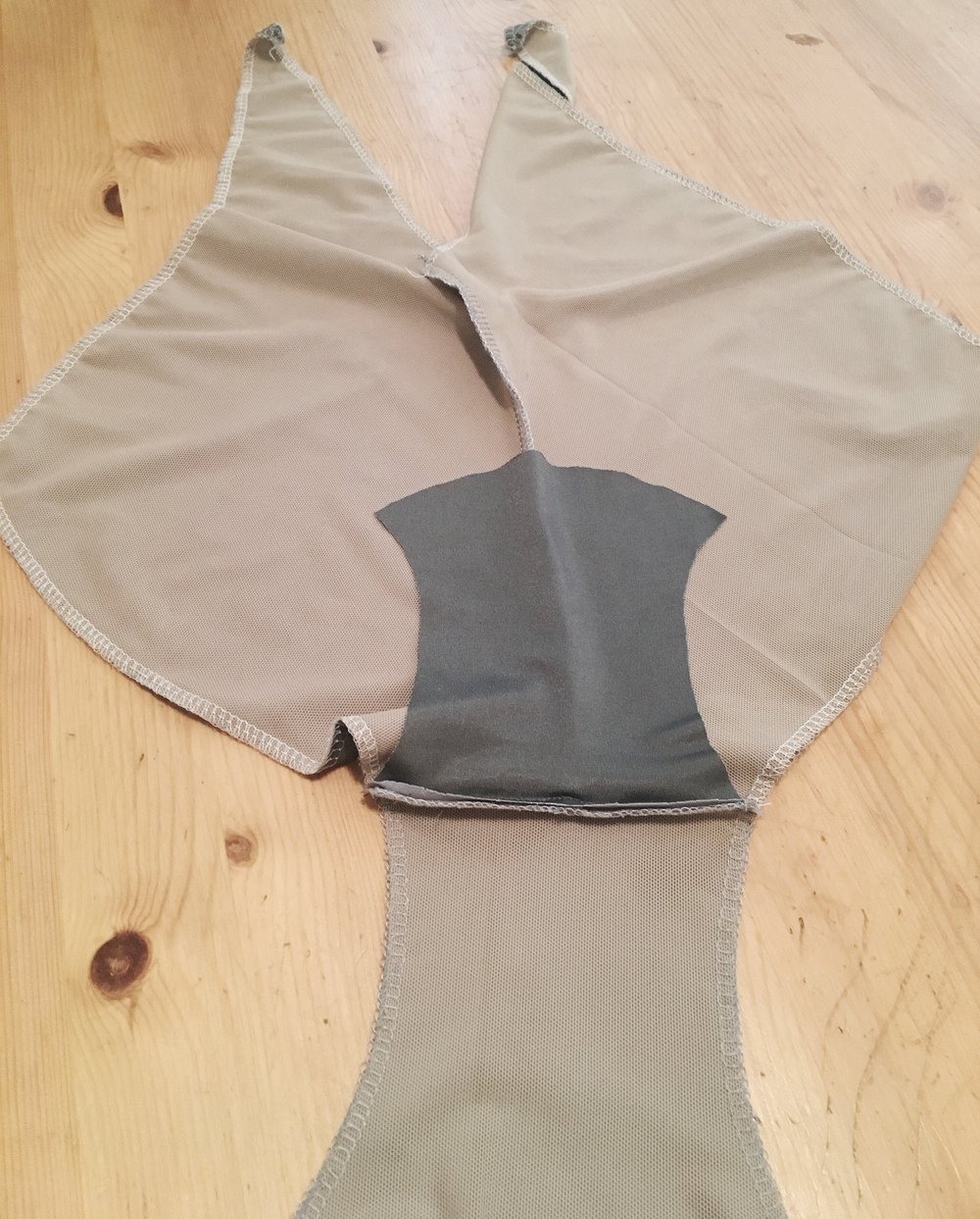 Crotch lining is attached only to one side- at the crotch seam.  The sides are caught in the leg elastic and the other end stays open.