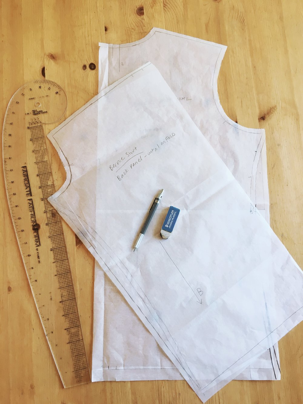 I traced the adjustment to the side seams on to my pattern pieces as best as I could.  I'll try to figure out how to true that intersection with the armscye later...