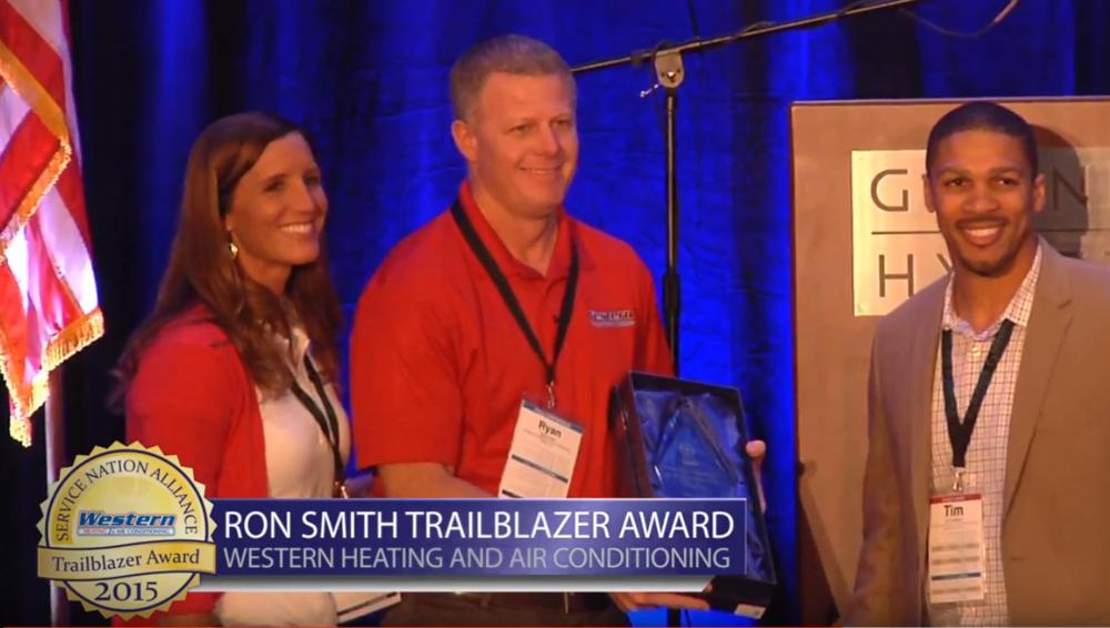 Ryan Snow receiving the 2015 Ron Smith TrailBlazer Award.