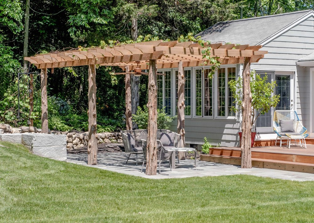 Pergola with raw cedar posts
