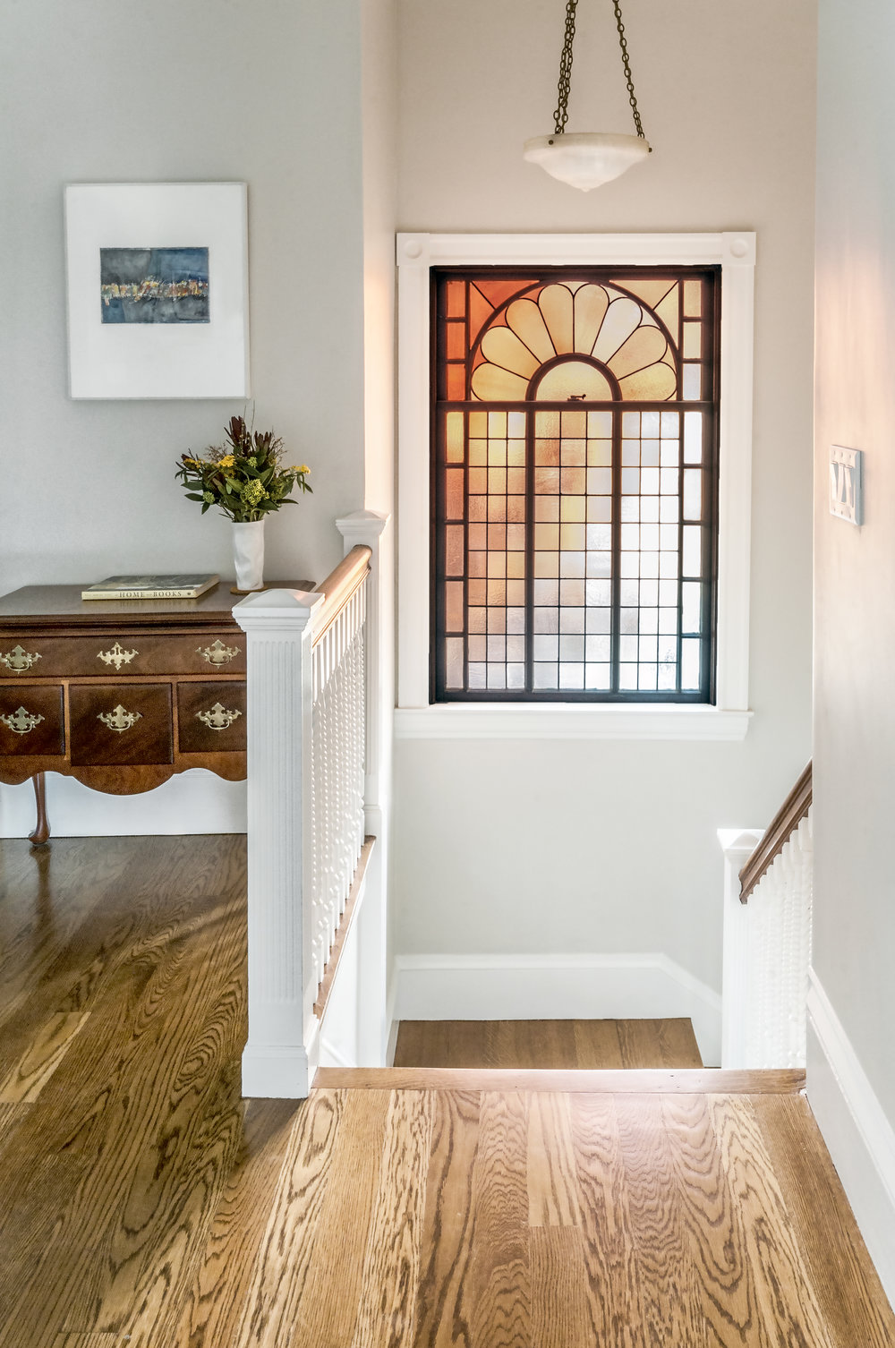 Stairway with custom leaded glass window