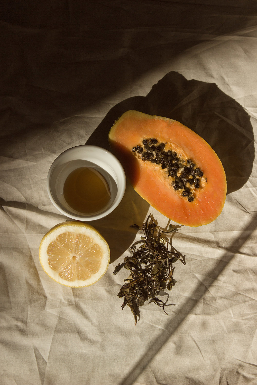 Ingredients -  1 slice of Papaya1 slice of Lemon2 teaspoons HoneyA few teaspoons of loose White Tea