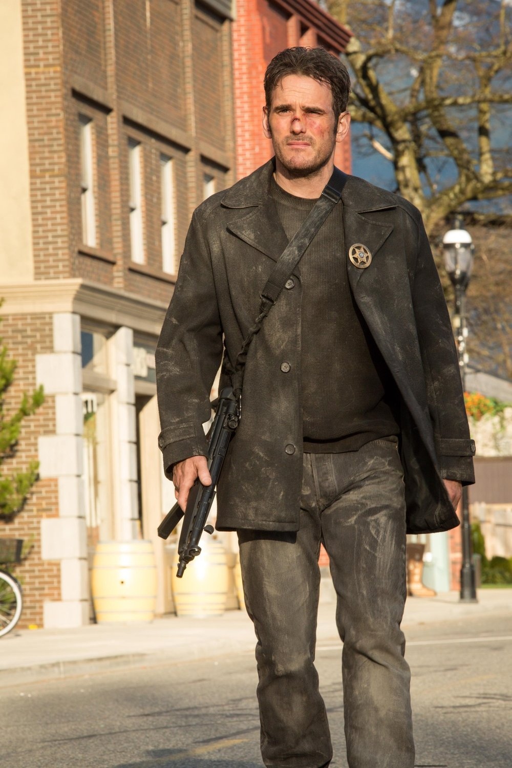 "WAYWARD PINES:  Ethan (Matt Dillon) patrols Main Street in the ""Cycle"" season finale episode of  Wayward Pines"