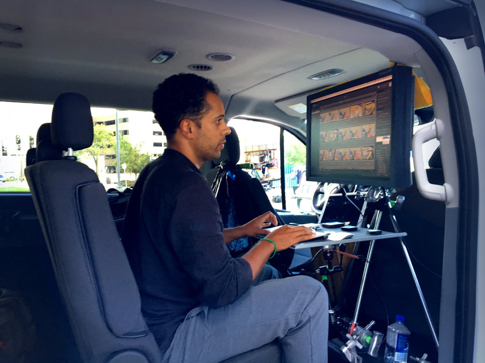 Digital Tech/First Assistant Demetrius Fordham downloading CF cards into Lightroom to a laptop in our digital mobile van. ©Doug Menuez using iPhone6s