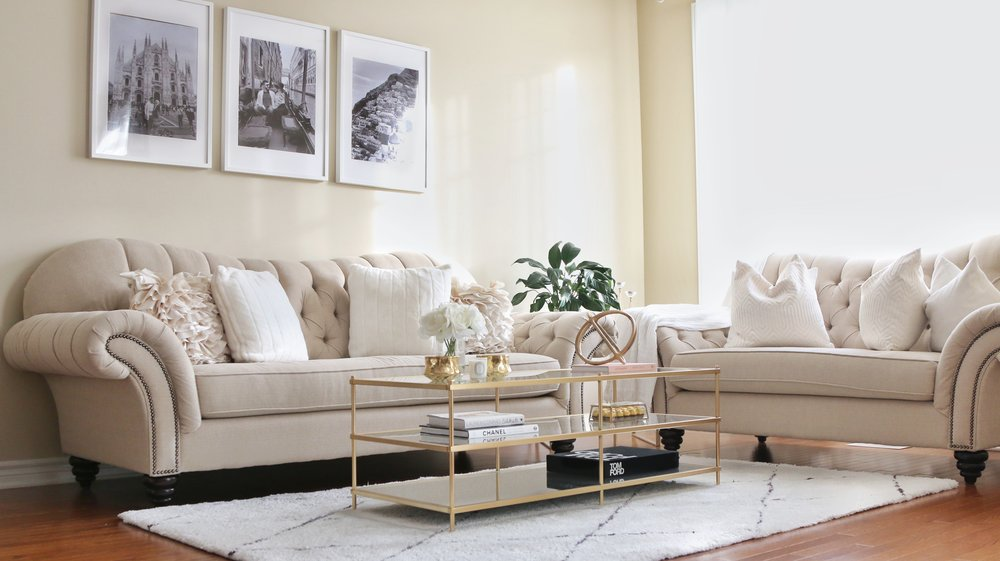beige living room with gold accents.jpg