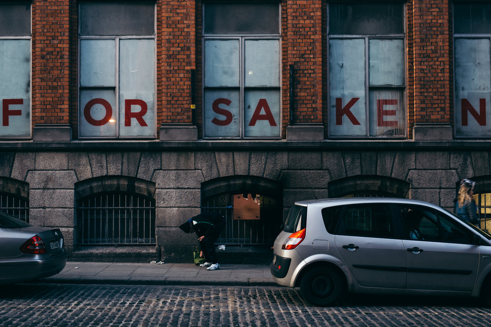Homeless man bowed over in Dublin's Temple Bar. Photographer:  Jack Farrell