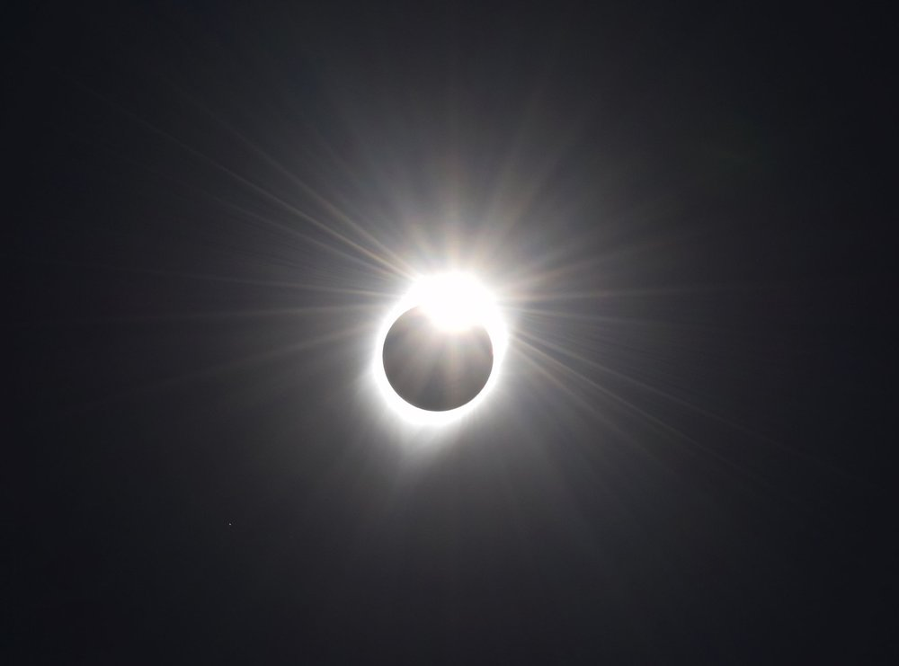"The ""diamond ring"" effect just after totality ends, and the moon moves on."