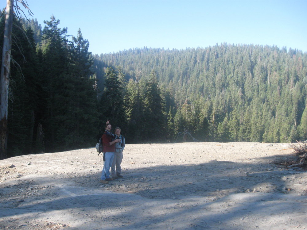 My parents taking a break on the hike out to Muir Grove.