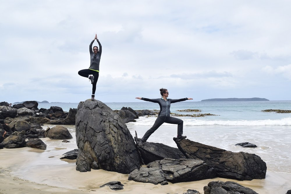 Kat and Becca show off their yoga skills at Dead Man Beach.