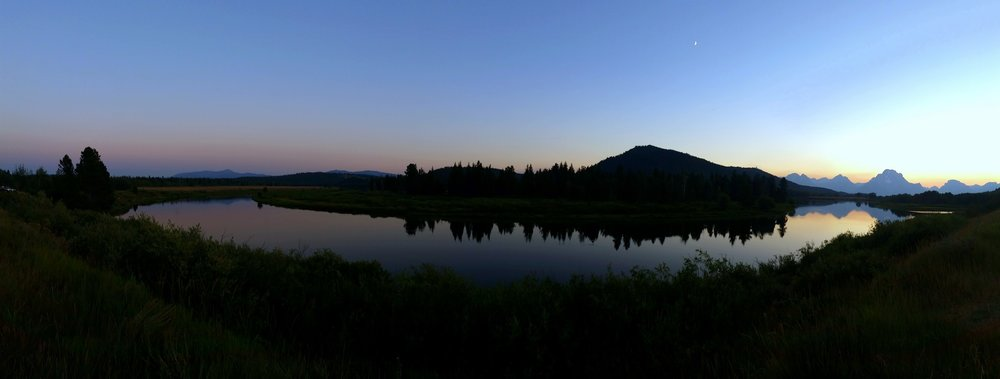 Sunset over the Tetons and moonrise over Oxbow Bend in Grand Teton National Park.