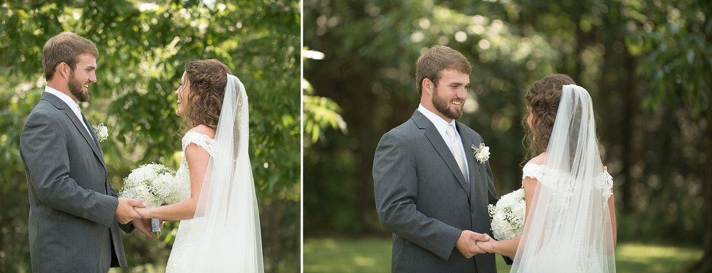Bride and groom enjoy sharing a sweet moment together during their first look outside under beautiful green pecan trees