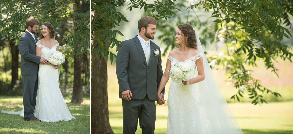 groom in gray tuxedo looks lovingly into his brides eyes while embracing her