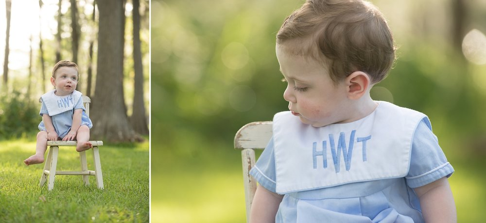 baby boy in blue heirloom outfit sits in a rustic white chair outdoors