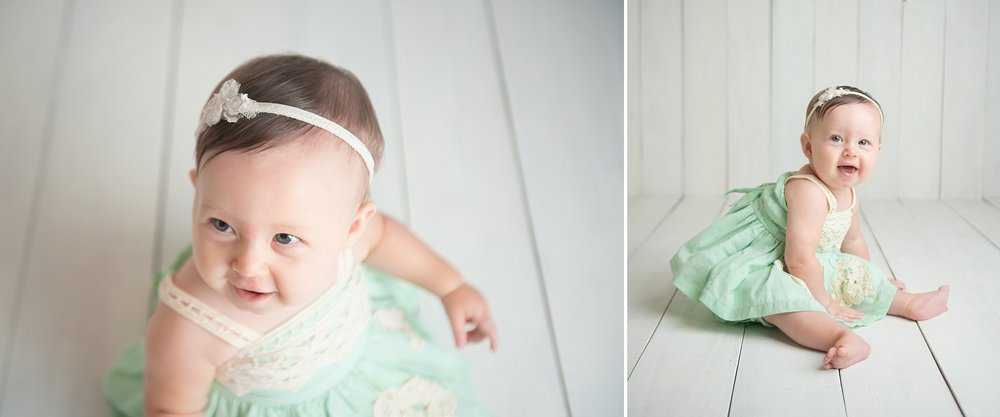 9 month old baby girl laughs and claps in mint green dress