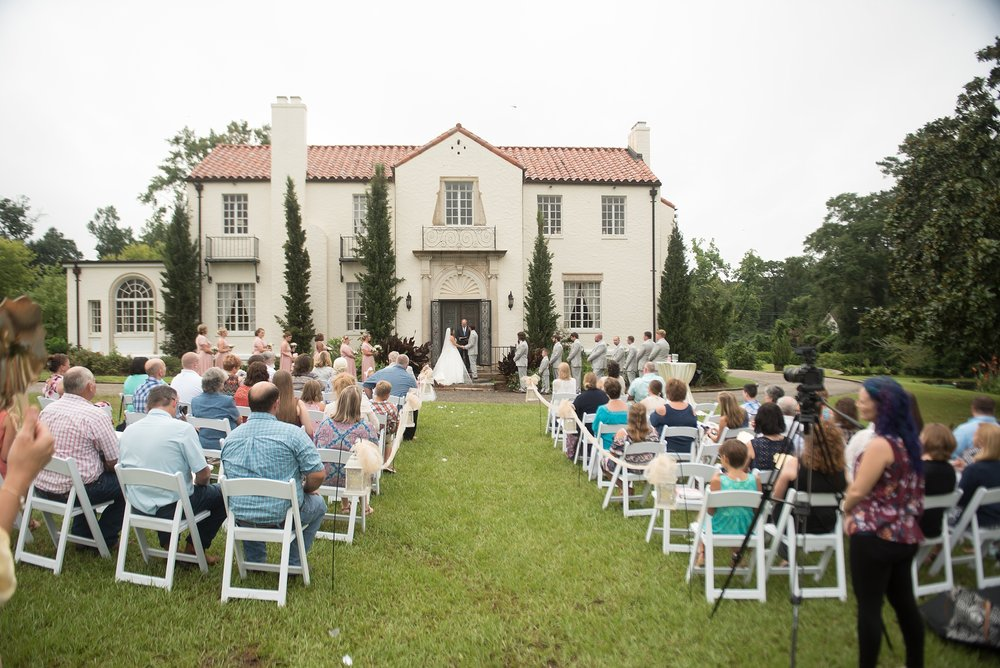Guests look on as bride and groom say their vows at Springdale in Andalusia, Alabama