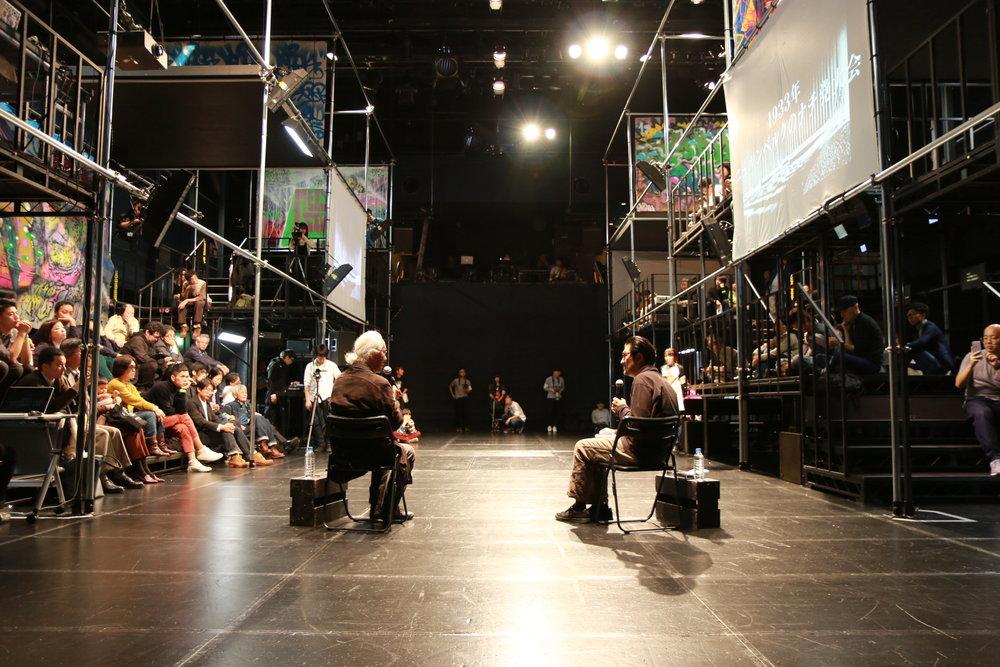 Theater Director,Akira Takayama talking with Architect, Arata Isozaki.