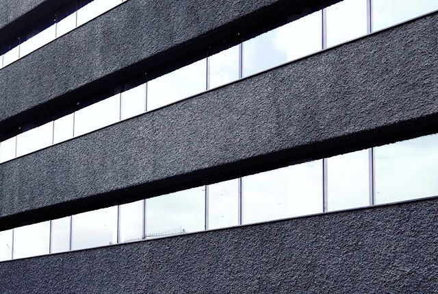 Stripes of rough dark concrete - Jordan Office Building in Tehran.  #office #officebuilding  #concrete #Tehran #Iran #facade #rough #stripe #bands #flexible #openoffice #art #architecture #black #texture #noise #tone #architecture #experimental #interiordesign #archdaily #glass #grid #instagram