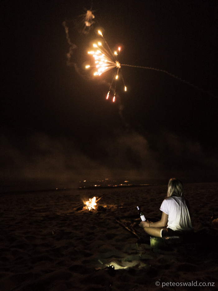 boom. wine, beach, fire, stars, the girl and fireworks
