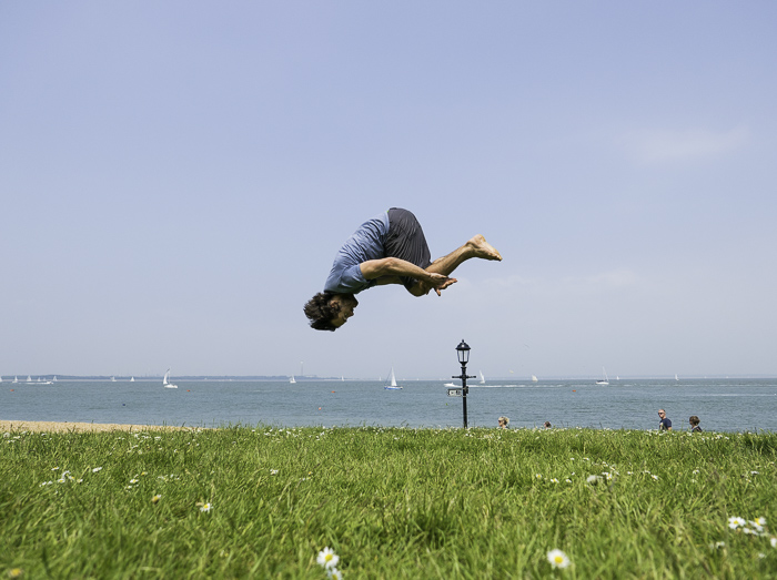 Front flip on the grass on Cowes Green, Isle of Wight UK. Photo: Sophie Stevens