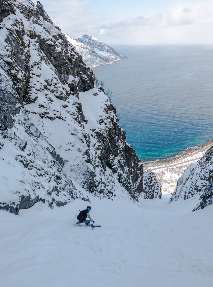 Soph skiing to the sea at Senja. Photo by: Pete Oswald