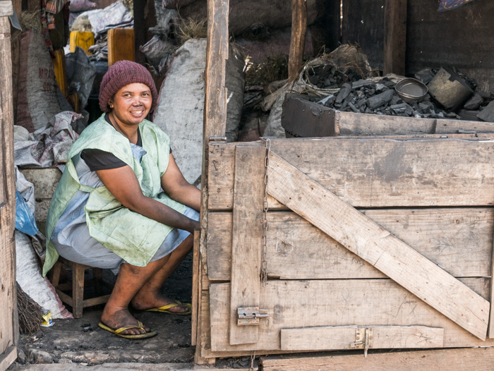 A woman sells charcoal in Antananarivo