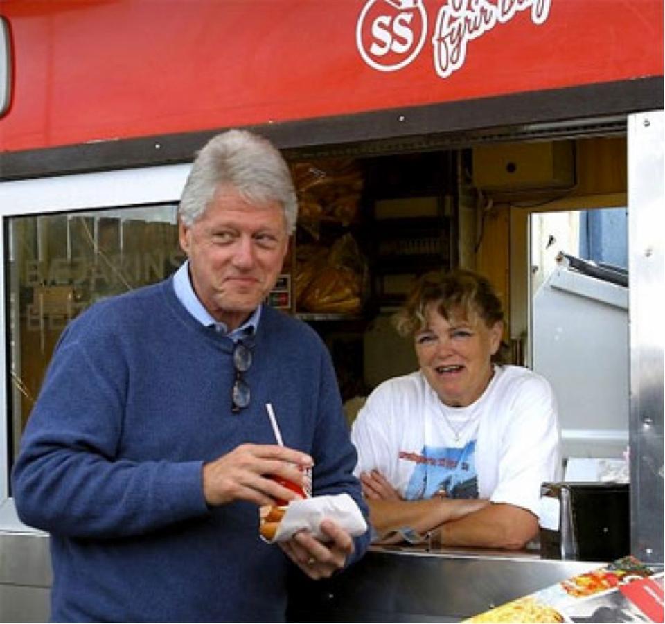 Bill Clinton enjoying his hot dog