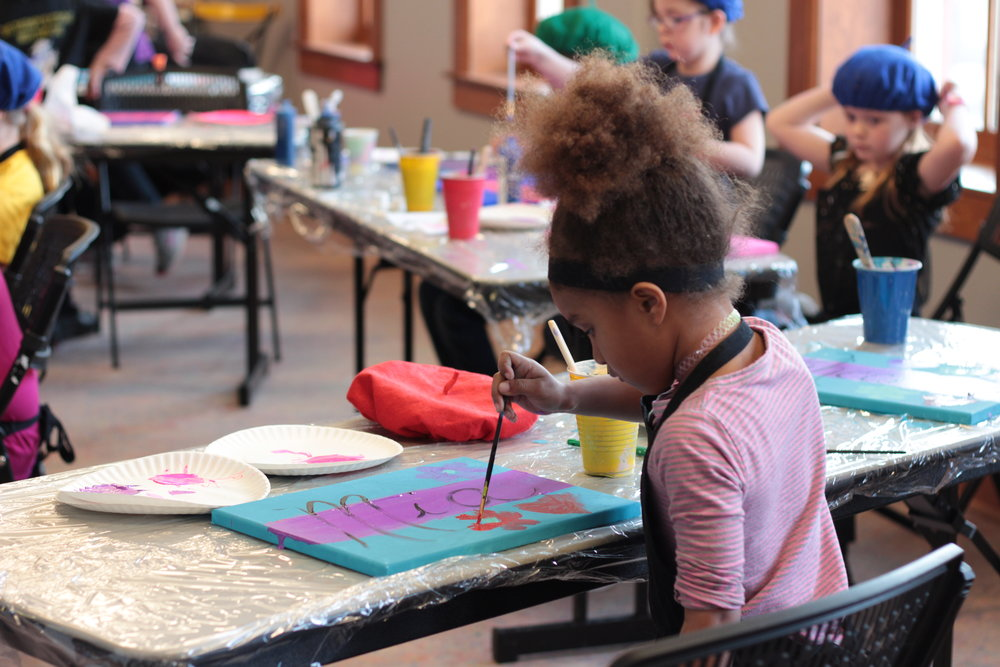 Students painting in the Arts Education Area